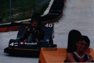 photo of Kimber driving a miniature race car
